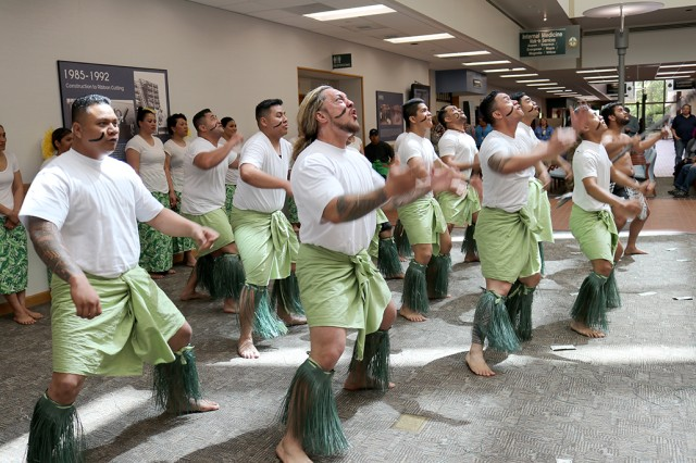 "The male dancers of the ""JBLM Soldiers of the Pacific Islands"" group perform a haka to traditional music May 10 in recognition of Asian Pacific American Heritage Month at Madigan Army Medical Center, Joint Base Lewis-McChord, Washington."