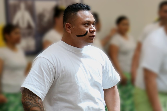 "A dancer with the ""JBLM Soldiers of the Pacific Islands"" group shows impressive intensity as he performs a haka to traditional music May 10 in recognition of Asian Pacific American Heritage Month at Madigan Army Medical Center, Joint Base Lewis-McChord, Washington."