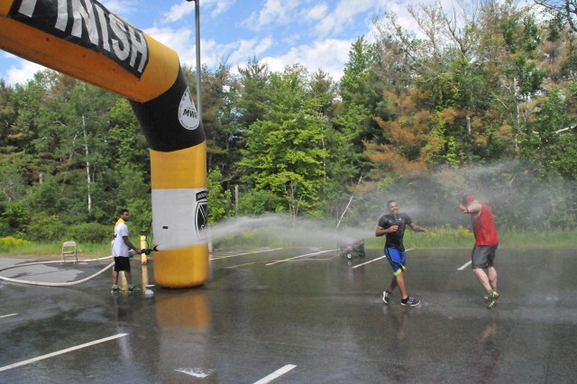 A free shower awaits muddy finishers when they complete the Mountain Mudder at Fort Drum, New York.