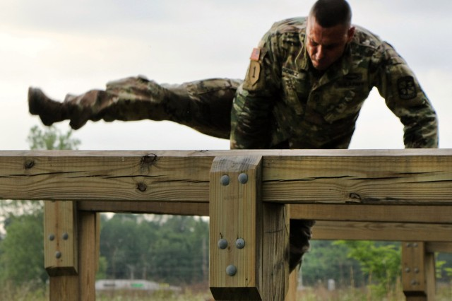 Sgt. 1st Class Samuel Gomez, 6th Brigade, clears the last hurdle on the obstacle course during the Best Warrior competition at Fort Knox.