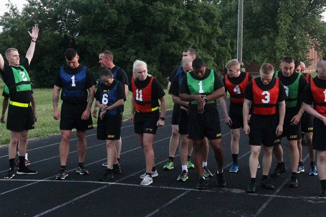 Sixteen Soldiers and NCOs line up for the run during the Army Physical Fitness Test on day one of the U.S. Army Cadet Command / Fort Knox Best Warrior competition May 21-23.