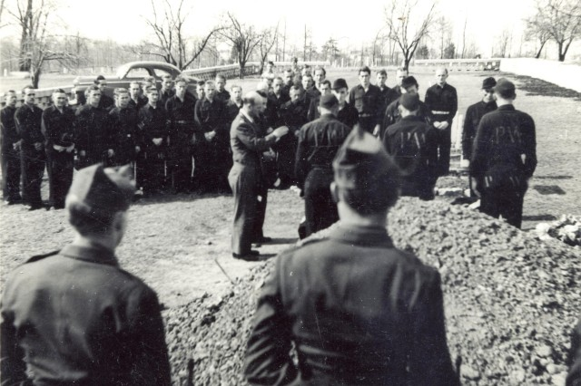 The funeral for German POW Nikolaus Stutz was photographed in March 1946, the same month POWs began departing the post for their final stint as POWs in Europe.