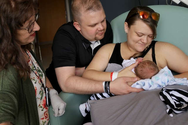 Maria Walden, a lactation consultant, supports new parents Jonathan and Janelle Williams May 30 as they begin their parenting and breastfeeding journey with 2-day-old Colton at Madigan Army Medical Center on Joint Base Lewis-McChord, Washington.