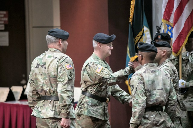 Brig. Gen. Paul H. Pardew passes the Army Contracting Command colors to Sgt. Maj. Kenneth Jackson, ACC acting command sergeant major, after accepting command. Gen. Gus Perna, Army Materiel Command commander, officiated the May 31 ceremony where Pardew assumed command from Maj. Gen. James E. Simpson.
