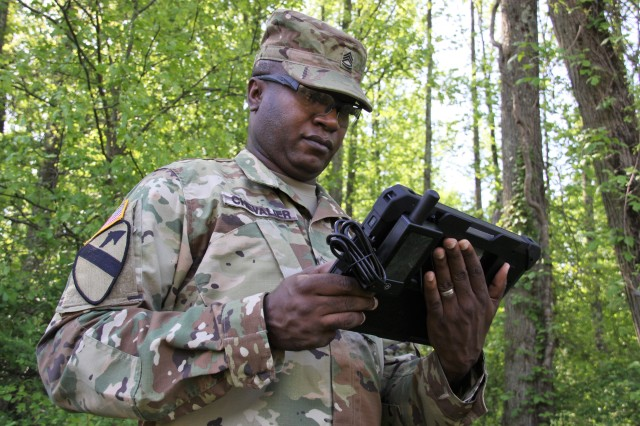 Sgt. 1st Class Edvar Chevalier, CERDEC senior enlisted adviser, works on the latest prototype of Expeditionary Joint Battle Command-Platform at Aberdeen Proving Ground, Maryland, May 11, 2018.