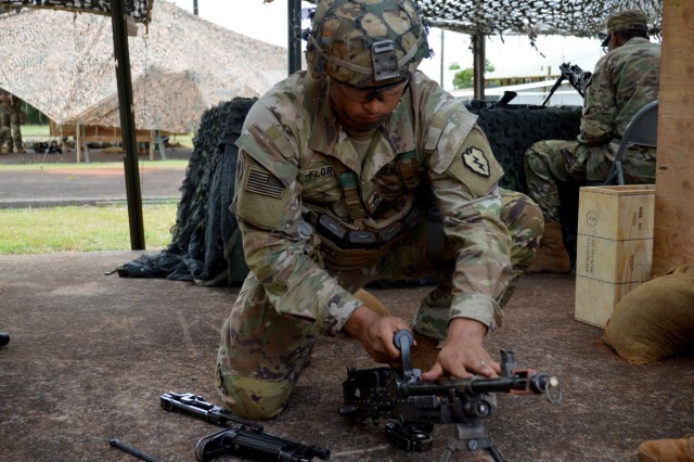 Staff Sgt. Manuel Flores, assigned to to1st Battalion, 27th Infantry Regiment, 2nd Brigade Combat Team, 25th Infantry Division, dissembles the M240B machine gun during Expert Infantryman Badge train up at Schofield Barracks, Hawaii, on May 31, 2018.  Infantrymen throughout the 25th ID are participating in this biannual event to earn the prestigious Expert Infantryman Badge. (U.S. Army photo by Staff Sgt. Armando R. Limon, 3rd Brigade Combat Team, 25th Infantry Division)