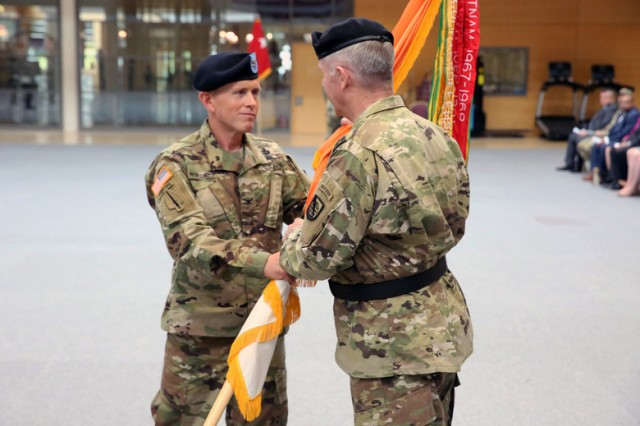 U.S. Army Col. Jeff Worthington passes the 2nd Theater Signal Brigade colors to U.S. Army Maj. Gen. John W. Baker, commanding general of U.S. Army Network Enterprise Technology Command, during a relinquishment of command ceremony June 1, 2018 in Wiesbaden, Germany.
