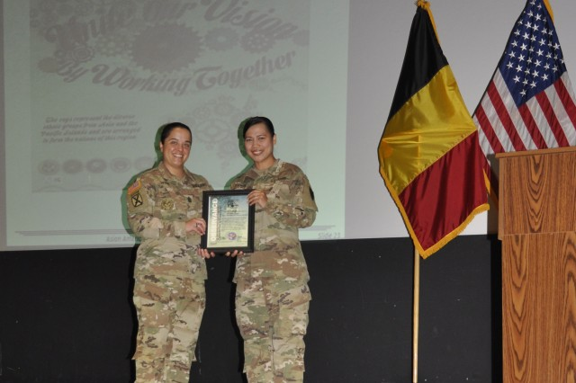 Command Sgt. Maj. Samara Pitre (left), garrison command sergeant major for U.S. Army Garrison Benelux, presents 1st Lt. Maria S. Godwin (right),  Assistant S3 for AFNORTH Battalion at SHAPE, with a certificate of observance during the garrison's Asian American and Pacific Islander Heritage Month observance May 30, 2018, at SHAPE, Belgium.