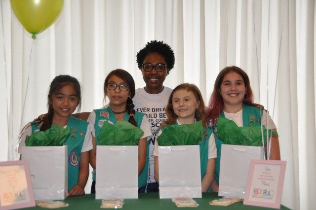 Laticia Brandy (center), Troop Leader, poses with the Bronze Award recipients during an award ceremony May 23, 2018, at SHAPE, Belgium. The Girl Scout Bronze Award is the highest honor a Girl Scout Junior can achieve and recipients must devote at least 20 hours to their projects and truly accomplish the Girl Scout mission of developing courage, confidence and character to make the world a better place.