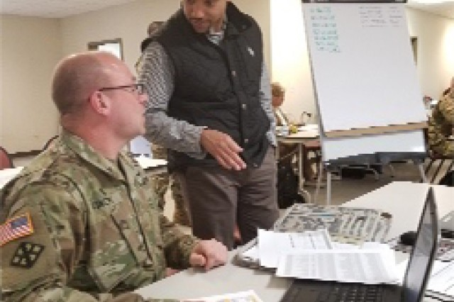 Jeffrey Thomas, Army G-1, senior program analyst and User Jury facilitator (right) gets feedback from CW5 Jay Vincent (left), Sr. Personnel Advisor, G1, Massachusetts Army National Guard at a user jury at Fort Indiantown Gap, Pennsylvania.