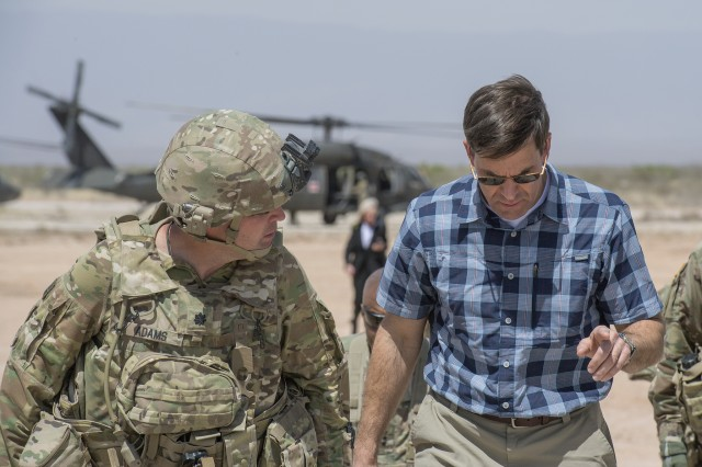 "Secretary of the Army Dr. Mark T. Esper speaks with a Soldier while visiting an Army installation. Esper recently laid out ""The Army Vision"" through 2028 that will ensure America's Soldiers are able to fight and decisively win in any future battle."