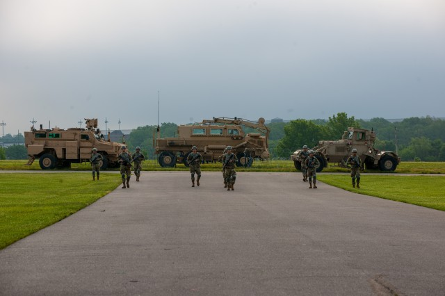Soldiers in Company C, 35th Engineer Battalion, conduct a breaching demonstration during their graduation ceremony held May 18 on Gammon Field. The demonstration is used to showcase the skill sets learned by the Soldiers during their One Station Unit Training at Fort Leonard Wood.