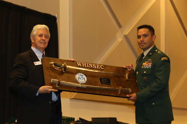 Colombian Army Lt. Col. Mauricio Esteban accepts the General Dwight D. Eisenhower Prize, a saber, as the International Distinguished graduate of Command & General Staff Officer Course, Class of 2018.   Lt. Col. (Ret) Ben Stahl, representing the Military Officer Association, is making the presentation.