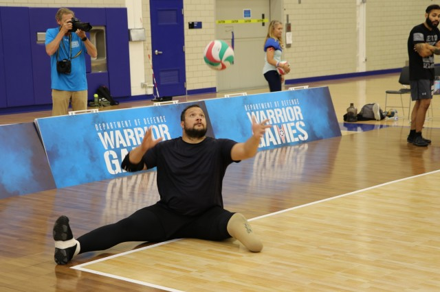 U.S. Army veteran Capt. Alex Wilson works on his service during sitting volleyball practice, May 30, 2018, at the U.S. Air Force Academy Cadet Center Gymnasium, in preparation for the 2018 Department of Defense Warrior Games.