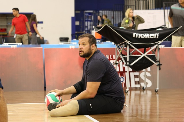 U.S. Army veteran Capt. Alex Wilson waits to get the go-ahead to serve during sitting volleyball practice, May 30, 2018, at the U.S. Air Force Academy Cadet Center Gymnasium, in preparation for the 2018 Department of Defense Warrior Games.
