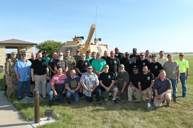 "About 30 former and current tankers from Company B, 4th Battalion, 37th Armor Regiment, held a reunion at Fort Riley, Kansas, May 18. Maj. Gen. Joseph Martin, 1st Infantry Division and Fort Riley commanding general, was the ""Bravo"" company commander when the unit deployed to support Operation Desert Storm. The Soldiers toured parts of Fort Riley for the first time in nearly 25 years. They were also able to see the most modern version of the Abrams tank, meet current tanker Soldiers, review artifacts from their time in Desert Storm and more. (Photos by Chad L. Simon, 1st Inf. Div. public affairs office)"