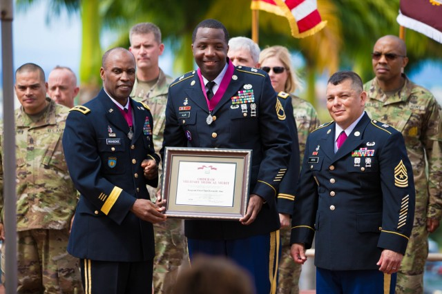 HONOLULU, Hawaii (June 1, 2018) - Regional Health Command-Pacific Equal Opportunity Advisor (EOA), Master Sgt. Erron Alor (center) is the Army's premier EOA, taking home the recognition at the Secretary of the Army Awards in Washington, DC today at the Pentagon. Here, Alor is depicted receiving another recognition, the Order of Military Medical Merit during a ceremony April 26 at Tripler Army Medical Center, standing alongside RHC-P Commanding General, Brig. Gen. Bertram Providence (left) and RHC-P acting Senior Enlisted Advisor, Command Sgt. Maj. Larry Reyes (right). (courtesy photo)