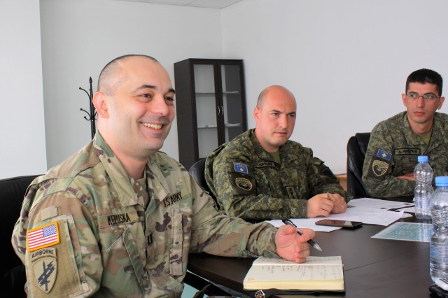 Capt. Gent Kepuska works with Centre for University Studies Commander Capt. Vegim Krelani and Deputy Commander Capt. Adem Preteni in Pristina, Kosovo, on May 22. Kepuska is part of a U.S. Army team that is advising the Centre for University Studies on the training of Kosovo Security Force cadets.