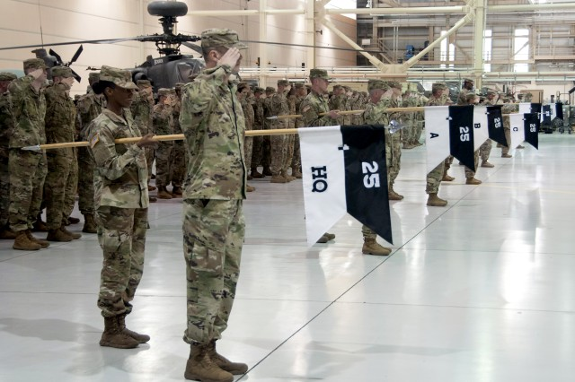 Soldiers from 1st Battalion, 25th Aviation Regiment, 25th Combat Aviation Brigade, 25th Infantry Division stand in formation during a color casing ceremony at Fort Wainwright, Alaska June 1, 2018. The battalion, along with Troop B, 2nd Squadron, 6th Cavalry Regiment, 25th CAB will deploy as part of a routine rotation of aviation assets to the Republic of Korea.