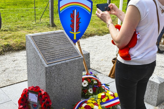 A citizen of Tournières takes a picture of the General Eisenhower Monument June 2, 2018 in Tournières, France, following the wreath-laying ceremony.