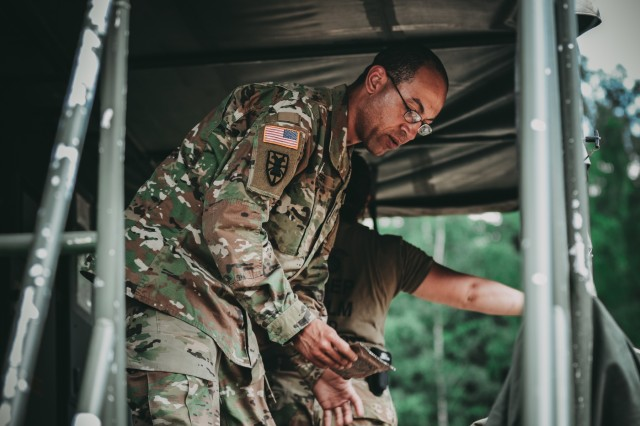 Sgt. Carlo Grier of the 464th Quartermaster Company of Lapeer, Michigan, prepares to eat after a long day at work in the field during Saber Strike 18, June 1, 2018. The Saber Strike exercises have created a foundation for the strong relationships the United States shares with several European allies and partners today.
