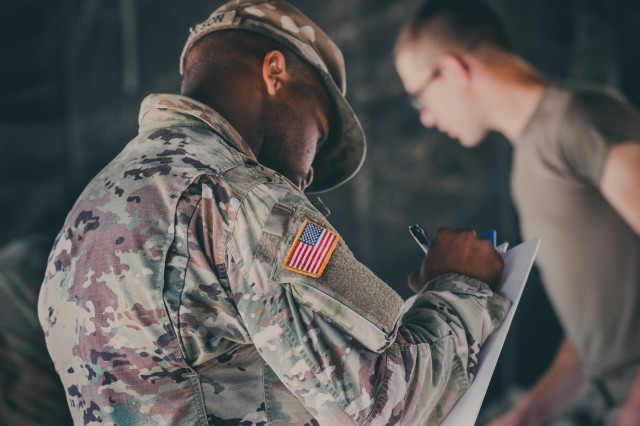A soldier from the 464th Quartermaster Company prepares his laundry ticket to drop off clothing during field operations at Land Forces Training Center Drawsko, Poland in support of Saber Strike 18. Soldiers from each component benefit from the cooperative training opportunities provided by the exercise.