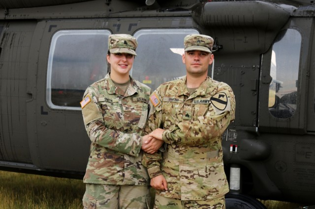 Sgt. Amanda Smith, a religious affairs non-commissioned officer with the 3-227th Assault Helicopter Battalion based out of Fort Hood, Texas, holds hands with her husband, Sgt. James Smith, a technical inspector for the Apache helicopters with the 1-227th Attack Reconnaissance Battalion. The two are part of the 1st Air Cavalry Brigade, which is in Poland participating in Saber Strike, an exercise designed to enhance the interoperability of many nations and their ability to work together like the Smiths.