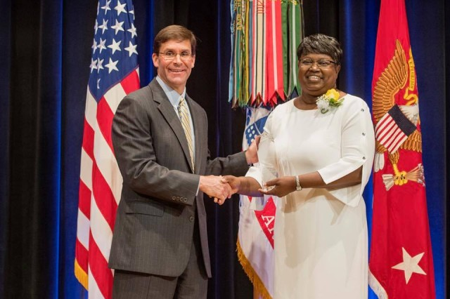 """Secretary of the Army Dr. Mark T. Esper, left, congratulates U.S. Army Forces Command's Director of Equal Employment Opportunity Paulette Y. Reese June 1 during a Pentagon awards ceremony, where she was recognized with the """"Secretary of the Army Award for Diversity and Leadership for Equal Employment Opportunity Professional."""""""