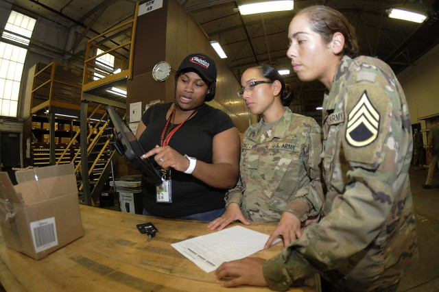 Shai'mel Bell, warehouse specialist, helps advanced individual training students Pvt. Jeanneth Martinez and Spc. Lorimay Melendez demonstrate using a training version of the Global Combat Support System-Army information system during a 92A Automated Logistical Specialist Course session recently. GCSSA is a web-based logistics tracking and transaction program used throughout the Army, but training gaps have somewhat hindered how effective it can be. The Quartermaster School's Logistics Training Department has addressed the issue with revamped training sessions designed to give AIT students a more robust training experience that it says will better prepare them to execute their duties in the field.