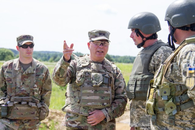 Maj. Gen. Raymond Shields, commander of the New York Army National Guard meets with U.S. and Ukrainian Soldiers during a visit to the Yavoriv Combat Training Center here May 25. During his visit Shields met with JMTG-U leaders and awarded challenge coins to U.S. service members to recognize them for their hard work.