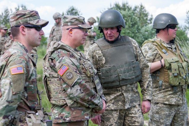 Maj. Gen. Raymond Shields, commander of the New York Army National Guard meets U.S. and Ukrainian Soldiers during a visit to the Yavoriv Combat Training Center here May 25. During his visit Shields met with 27th IBCT Soldiers and awarded challenge coins to U.S. service members to recognize them for their hard work.