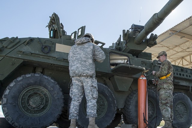 Soldiers from the 1st Stryker Brigade Combat Team, 25th Infantry Division perform maintenance on the mobile gun system of a Stryker at Fort Irwin, Calif., on Jan. 11, 2017.