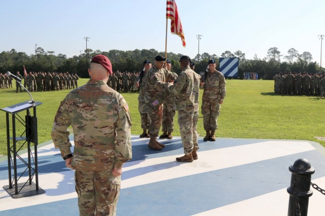 """Lt. Col. Perry O. Stiemke, battalion commander, 92nd Engineer Battalion, 20th Engineer Brigade and Command Sgt. Maj. Dwayne D. Hite, battalion command sergeant major, 92nd Engineer Battalion, 20th Engineer Brigade case their unit's colors during a deployment casing ceremony at Cottrell Field on Fort Stewart, Georgia, June 1, 2018.  Over 500 Soldiers from the """"Black Diamond"""" battalion will be spread throughout the Central Command area of operation and provide  engineer support to conduct construction, clearance, combat engineer mobility, counter mobility and survivability missions. (U.S. Army photo by Sgt. Joseph Truckley/ released)"""