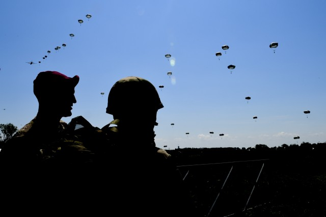 Paratroopers look on as others fall from the sky June 3 near Sainte-Mere-Eglise, France, during the D-Day 74 commemorative airborne operation.This year marks the 74th anniversary of Operation Overlord, the Allied invasion of Normandy on June 6, 1944 -- most commonly known as D-Day. An epic multinational amphibious and airborne operation, D-Day forged partnerships and reinforced transatlantic bonds that remain strong today. Overall, U.S. service members from 20 units in Europe and the U.S. will participate in events and ceremonies May 30-June 7, in almost 40 locations throughout the Normandy region of France as part of Joint Task Force Normandy 74.