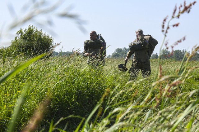 Paratroopers walk through thick brushes of grass from the landing zone June 3 after completing the D-Day 74 airborne operation near Sainte-Mere-Elglise, France. This year marks the 74th anniversary of Operation Overlord, the Allied invasion of Normandy on June 6, 1944 -- most commonly known as D-Day. An epic multinational amphibious and airborne operation, D-Day forged partnerships and reinforced transatlantic bonds that remain strong today.  Overall, U.S. service members from 20 units in Europe and the U.S. will participate in events and ceremonies May 30-June 7, in almost 40 locations throughout the Normandy region of France as part of Joint Task Force Normandy 74.