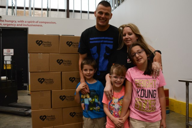 MIDLAND, Ga. (June 4, 2018) -- Soldiers of Charlie Company, 1st Battalion, 46th Infantry Regiment, at Fort Benning, Georgia, and their Family members, pack boxes of food June 1 at the Feeding the Valley Food Bank in Midland, Georgia, during a community service project. The food bank is one of eight regional food banks in Georgia and is the centralized source for receiving and distributing donated food, produce and grocery products to families in need. (U.S. Army photo by Megan Garcia, Maneuver Center of Excellence, Fort Benning Public Affairs)