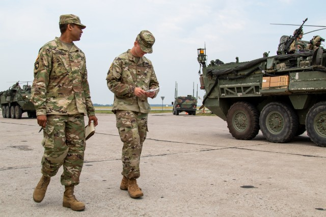 U.S. Army Reserve Staff Sgt. Orlando Stamps and Spc. Matthew Anderson, both transportation coordinators with 1172nd Movement Control Team, 446th Transportation Battalion (Movement Control), count vehicles, trailers, weapons and personnel belonging to a convoy from 3rd Squadron, 2d Cavalry Regiment, during Saber Strike 18 at Powidz Air Base, Poland, June 2. Saber Strike is a long-standing U.S. Army Europe-led integrated training exercise that helps facilitate cooperation amongst the U.S., Estonia, Latvia, Lithuania, Poland and 19 other allied and partner nations, June 3-15 (U.S. Army Reserve photo by Spc. Daisy Zimmer, 221st Public Affairs Detachment).
