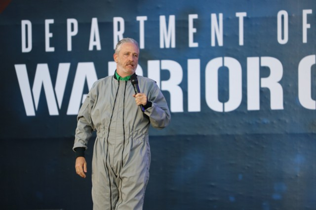 Master of Ceremonies, Actor/Comedian Jon Stewart revs up the crowd during opening ceremonies, June 2, 2018, at the U.S. Air Force Academy's Falcon Stadium at the 2018 Department of Defense Warrior Games, June 2 - 9. The DoD Warrior Games is an adaptive sports competition for wounded, ill and injured service members and veterans. Approximately 300 athletes representing teams from the Army, Marine Corps, Navy, Air Force, Special Operations Command, United Kingdom Armed Forces, Canadian Armed Forces, and the Australian Defence Force will compete in archery, cycling, track, field, shooting, sitting volleyball, swimming, wheelchair basketball, and - new this year - powerlifting and indoor rowing. (U.S. Army photo by Robert Whetstone)