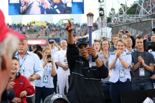 U.S. Army Staff Sgt. Altermese Kendrick carries the torch representing Team Army during the opening ceremony, June 2, 2018, at the U.S. Air Force Academy's Falcon Stadium at the 2018 Department of Defense Warrior Games, June 2 - 9. The DoD Warrior Games is an adaptive sports competition for wounded, ill and injured service members and veterans. Approximately 300 athletes representing teams from the Army, Marine Corps, Navy, Air Force, Special Operations Command, United Kingdom Armed Forces, Canadian Armed Forces, and the Australian Defence Force will compete in archery, cycling, track, field, shooting, sitting volleyball, swimming, wheelchair basketball, and - new this year - powerlifting and indoor rowing. (U.S. Army photo by Robert Whetstone)