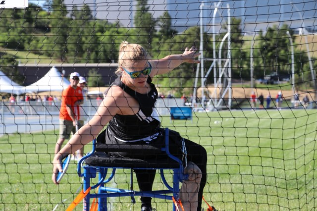 U.S. Army Pfc. Lauren Jahn launches her first throw during the seated discus event June 2, 2018, at the U.S. Air Force Academy outdoor track facility during the 2018 Department of Defense Warrior Games, June 2 - 9. The DoD Warrior Games is an adaptive sports competition for wounded, ill and injured service members and veterans. Approximately 300 athletes representing teams from the Army, Marine Corps, Navy, Air Force, Special Operations Command, United Kingdom Armed Forces, Canadian Armed Forces, and the Australian Defence Force will compete in archery, cycling, track, field, shooting, sitting volleyball, swimming, wheelchair basketball, and - new this year - powerlifting and indoor rowing. (U.S. Army photo by Robert Whetstone)
