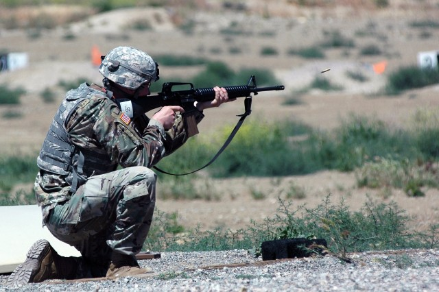 CAMP ROBERTS, California -- Staff Sgt. Sean Webber, Company D, 229th Military Intelligence Battalion, engages pop-up targets at the qualification range here May 19 during the unit's drill sergeant of the year competition.