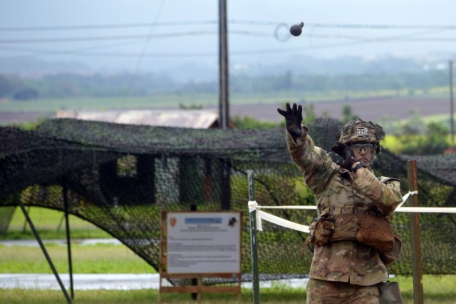 Cpl. Ryan Ives, an infantryman assigned to 1st Battalion, 27th Infantry Regiment, 2nd Brigade Combat Team, 25th Infantry Division, tosses a dummy grenade at the identify and employ hand grenades station during Expert Infantryman Badge train up at Schofield Barracks, Hawaii, on June 4, 2018.  Infantrymen throughout the 25th ID are participating in this biannual event to earn the prestigious Expert Infantryman Badge. (U.S. Army photo by Staff Sgt. Armando R. Limon, 3rd Brigade Combat Team, 25th Infantry Division)