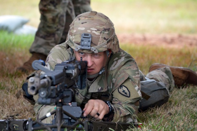 Staff Sgt. Robert Dzula, an infantryman assigned to 2nd Battalion, 35th Infantry Regiment, 3rd Brigade Combat Team, 25th Infantry Division, sites a weapon at the prepare a range card for a M240B machine gun during Expert Infantryman Badge train up at Schofield Barracks, Hawaii, on June 4, 2018.  Infantrymen throughout the 25th ID are participating in this biannual event to earn the prestigious Expert Infantryman Badge. (U.S. Army photo by Staff Sgt. Armando R. Limon, 3rd Brigade Combat Team, 25th Infantry Division)