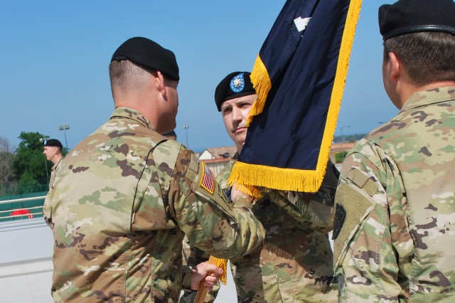 Lt. Col. Keith Toler, incoming battalion commander of Allied Forces South Battalion, U.S. Army NATO Brigade, receive the battalion colors from USANATO Bde. commander, Col. Jason Riley during the AFSOUTH change of command and responsibility ceremony, in which the battalion marked the change between commanders and sergeants major. Toler took the reins from outgoing commander Lt. Col. John Misenheimer, and incoming senior enlisted leader Command Sgt. Maj. Serjio Pruneda took over for outgoing Command Sgt. Maj. John Gutierrez. (photo by Staff Sgt. Taneisha Glover, AFSOUTH Battalion)