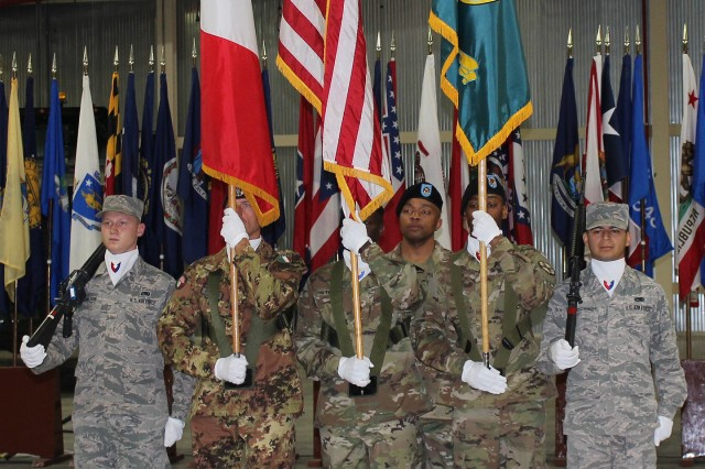 The Army Field Support Battalion-Africa color guard presents the colors during the change of command ceremony June 1 at Leghorn Army Depot in Livorno, Italy.