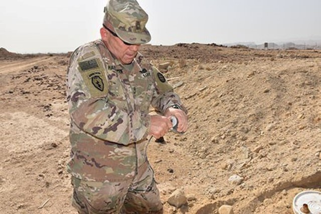 Master Sgt. Rodney Haesemeyer, 35th Engineer Brigade, Task Force Spartan, uses a soda can and electrical wiring found in trash to make a dummy improvised explosive devices (IED).  The fake IED is part of a practical exercise where Omani Soldiers demonstrated their equipment and tactics, techniques and procedures from their playbook combined with what had been shared the previous days from the U.S. Soldiers.