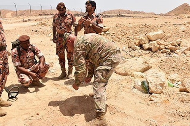 Maj. Brian Sayer, 35th Engineer Brigade, Task Force Spartan, shares with Omani Soldiers methods to determine the size of a possible improvised explosive devices (IEDs) they located during a multi-day training event. The training also gave the Omani soldiers an opportunity to demonstrate the use of equipment they use to counter the threat posed by IED.