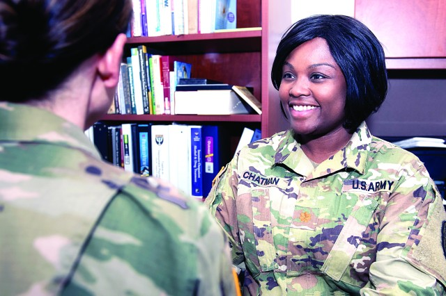 Maj. Ebony Chatman, clinical nurse officer in charge of the Residential Treatment Facility at Eisenhower Army Medical Center, speaks with a patient in the tactility in mid-May.