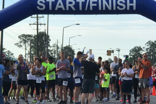 Runners gathered at the starting line in preparation to run the 5K course during the first-ever Fort Stewart Remembrance Run at Fort Stewart June 2.