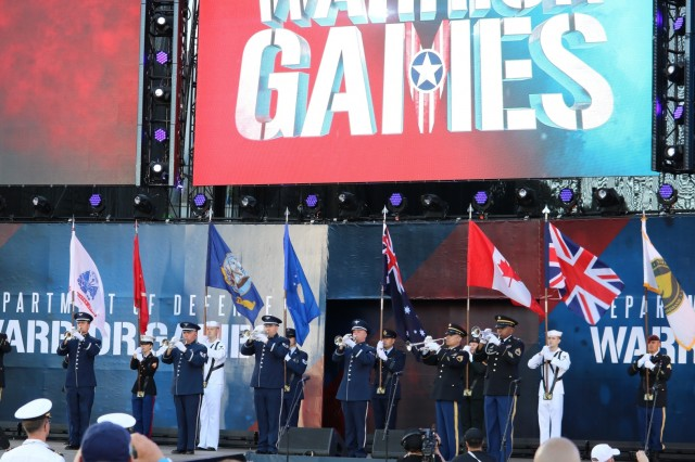 U.S. uniformed buglers performed the military song of each branch of service, to include United Kingdom Armed Forces, Canadian Armed Forces, and the Australian Defence Force during the opening ceremony, June 2, 2018, at the U.S. Air Force Academy's Falcon Stadium at the 2018 Department of Defense Warrior Games, June 2 - 9. The DoD Warrior Games is an adaptive sports competition for wounded, ill and injured service members and veterans. Approximately 300 athletes representing teams from the Army, Marine Corps, Navy, Air Force, Special Operations Command, United Kingdom Armed Forces, Canadian Armed Forces, and the Australian Defence Force will compete in archery, cycling, track, field, shooting, sitting volleyball, swimming, wheelchair basketball, and - new this year - powerlifting and indoor rowing. (U.S. Army photo by Robert Whetstone)